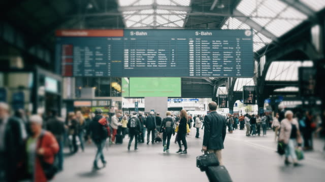 cinemagraph of people commuting  at train station in switzerland - railway station platform stock videos and b-roll footage