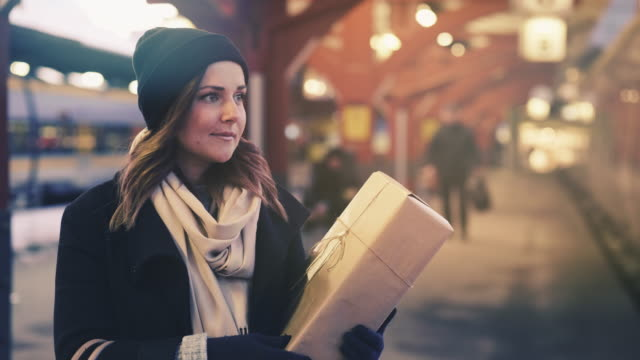 Cinemagraph of Woman with Christmas Gift on Train Station