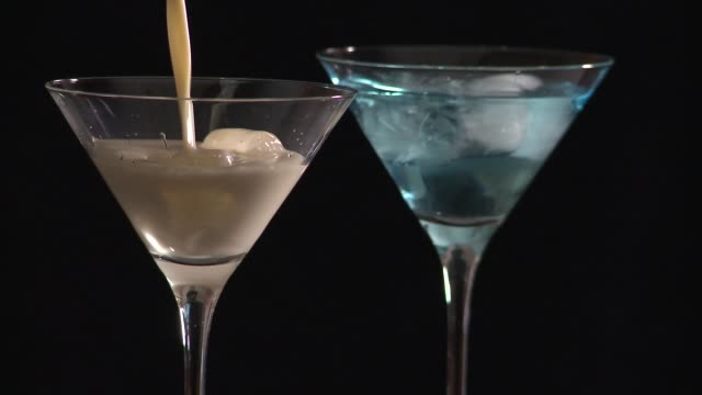 cinemagraph: pouring cocktail into martini glass - martini glass stock videos and b-roll footage