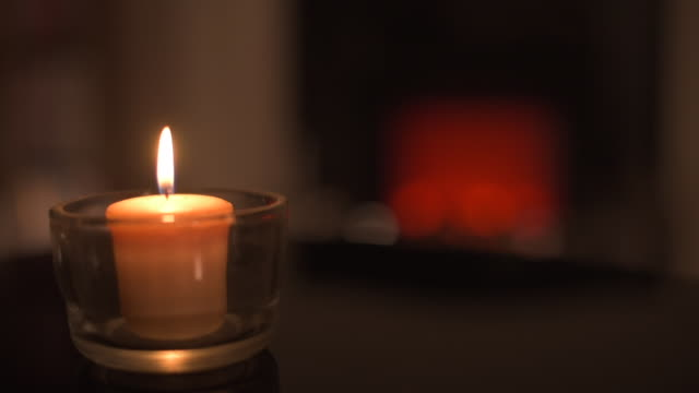 cinemagraph: subtle flickering candle in front of fire - cosy stock videos & royalty-free footage