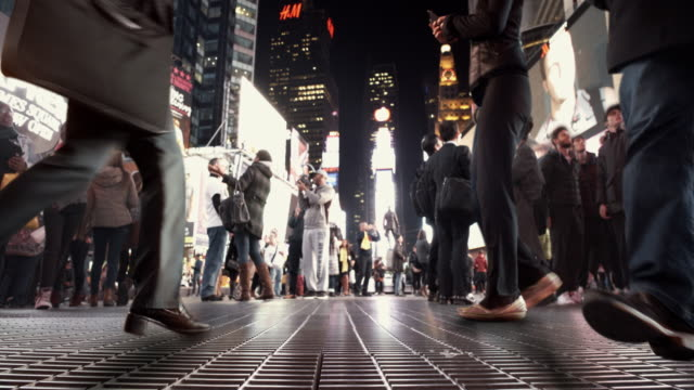 4k - cinema-graph tourists in time square nyc - photographing stock videos and b-roll footage