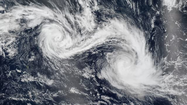 4k cinemagraph, twin tropical cyclones, two storms in the ocean churned quite close to each other - two objects stock videos & royalty-free footage