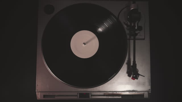 cinemagraph vintage vinyl disc on music turntable record player - turntable stock videos & royalty-free footage