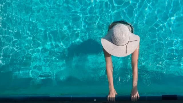 cinemagraph woman in the pool - infinity pool stock videos & royalty-free footage