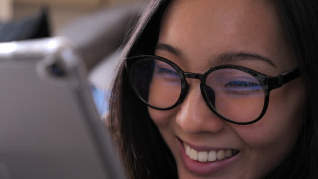 cinemagraph young asian woman with glasses using tablet - columnist stock videos & royalty-free footage