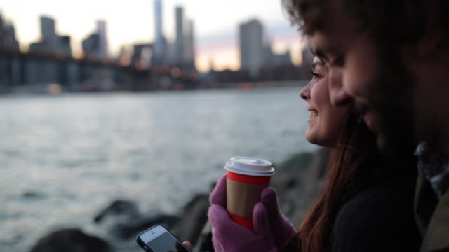cinemagraph, young couple enjoying sunset at brooklyn bridge, nyc - cinemagraph stock videos & royalty-free footage