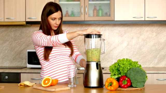 Cinemagraphs Woman blending fruits in blender