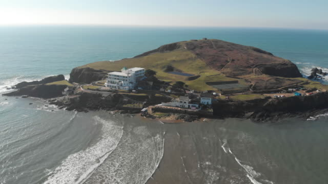 cinematic aerial drone footage of a beautiful island just off the coast of south devon, on a clear sunny day. - island stock videos & royalty-free footage