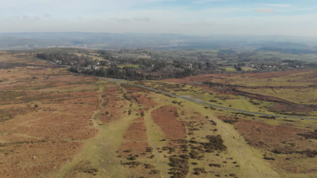 cinematic aerial drone footage of beautiful countryside greenery and natural granite rock formations in dartmoor national park devon uk - granite rock stock videos and b-roll footage