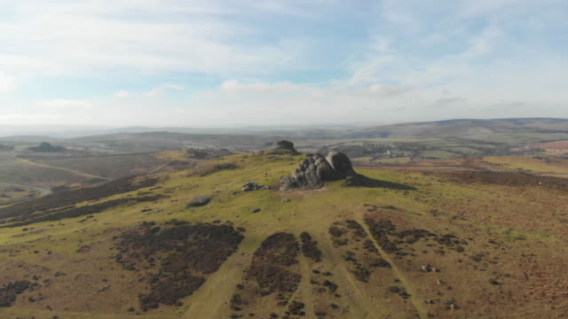 cinematic aerial drone footage of haytor rocks and the surrounding beautiful countryside in dartmoor national park, devon uk, hikers can be seen at... - landscape stock videos & royalty-free footage
