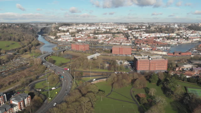 cinematic aerial shot of cumberland basin in bristol's harbourside clifton suspension bridge can be seen in the background - clifton suspension bridge stock videos and b-roll footage