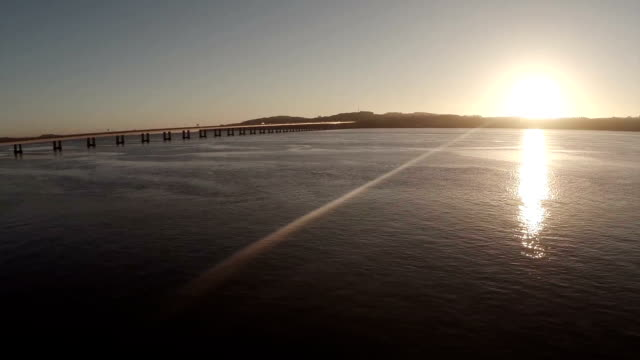 cinematic aerial shot of the tay bridge in dundee during sunrise on a calm morning - dundee scotland stock videos and b-roll footage