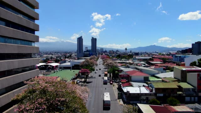 cinematic aerial view of the empty streets near the sabana and  roundabout  due to the quarentane of covid-19 in costa rica - san jose costa rica stock videos & royalty-free footage