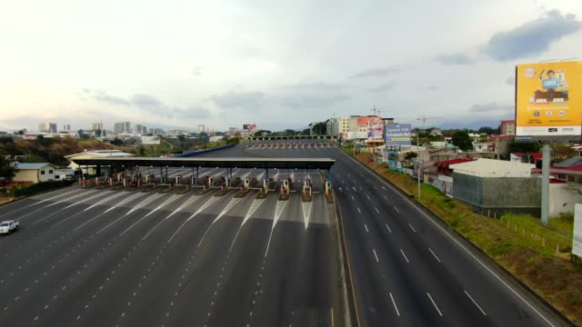 cinematic aerial view of the empty streets near the toll of the road 27 due to the quarentane of covid-19 in costa rica - aerial stock videos & royalty-free footage