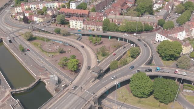 cinematic drone footage of an overpass in cumberland basin bristol england an industrial area of bristol's harbourside - motorway junction stock videos & royalty-free footage