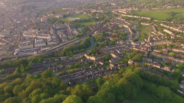 cinematic drone footage of bath uk during just before sunset showing buildings and surrounding countryside - establishing shot stock videos & royalty-free footage