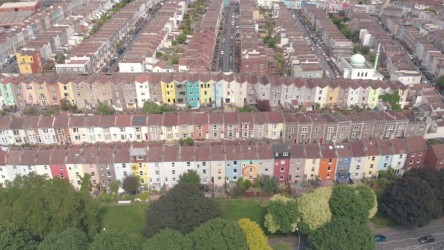 cinematic drone footage of the famous multicoloured houses of totterdown bristol on the edge of victoria park - residential district stock videos & royalty-free footage