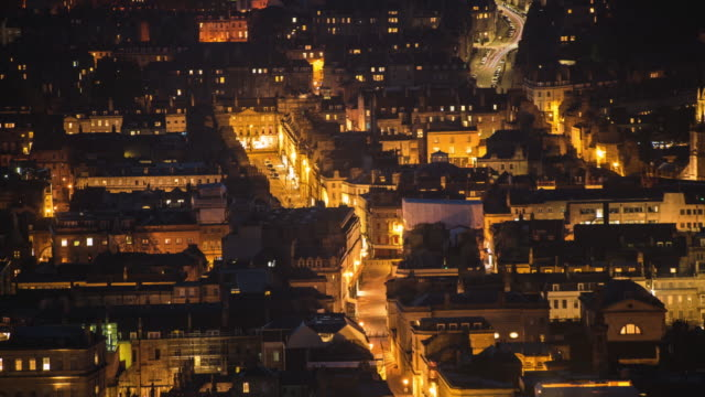 cinematic long exposure high angle time lapse of the city of bath uk, showing streets and georgian architecture of buildings lit up at night - town stock videos & royalty-free footage