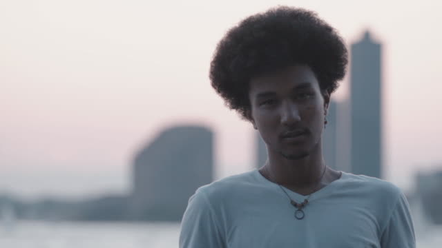 A cinematic, pensive portrait of a mixed race man along New York's Hudson River