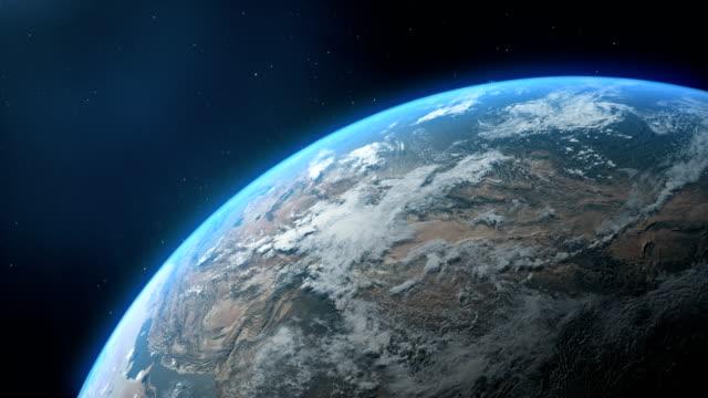 vídeos de stock e filmes b-roll de cinematic realistic rotating night earth cloud in space - médio oriente
