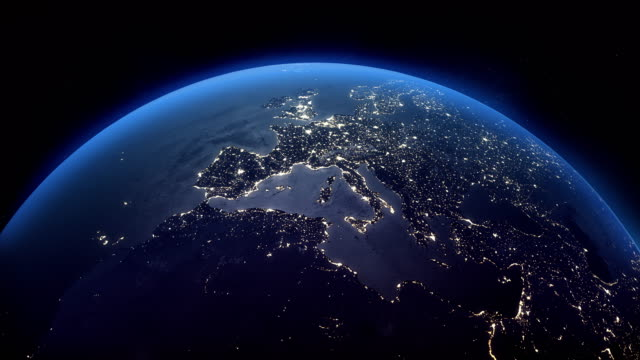cinematic realistic rotating night earth in space - europe stock videos & royalty-free footage