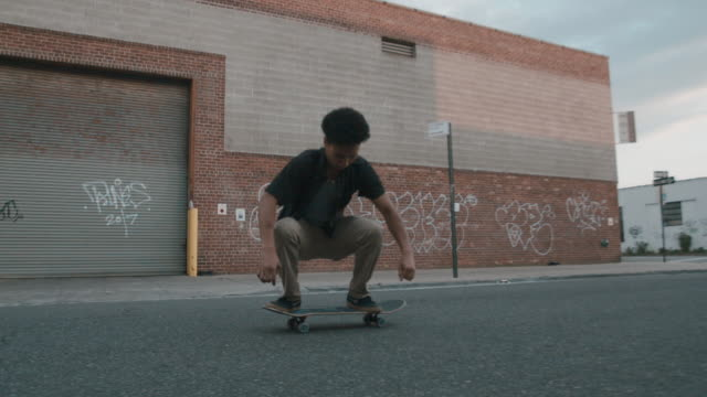 cinematic shot of a young skateboarder in the streets of brooklyn, nyc - slow motion - skateboarding stock videos & royalty-free footage