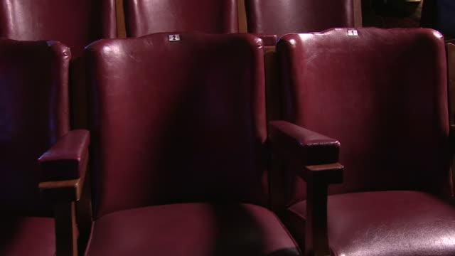 cinematic shot of cinema chairs - 席点の映像素材/bロール
