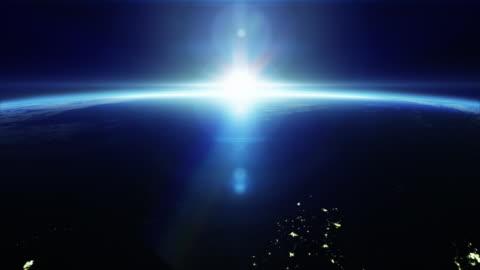 cinematic sunrise från rymden - med stadens ljus - 4k - möjlighet bildbanksvideor och videomaterial från bakom kulisserna