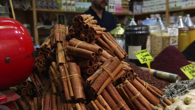 cinnamon in spice vendor stall - cinnamon stock videos & royalty-free footage