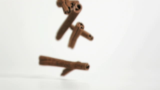 cinnamon sticks falling in super slow motion - medium group of objects stock videos & royalty-free footage