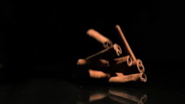 cinnamon sticks falling in super slow motion - cinnamon stock videos & royalty-free footage