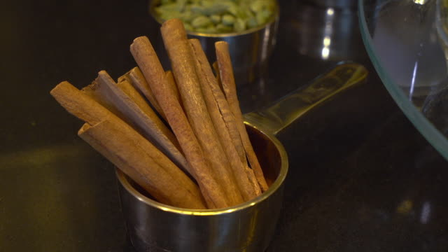 cinnamon sticks on a display - cinnamon stock videos & royalty-free footage