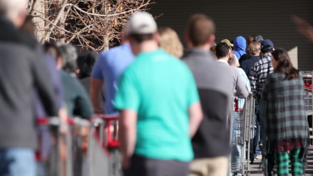 circa - - orem, utah - long line of shoppers making their pushing carts to store as they wait their turn to be allowed into supermarket during... - orem utah stock videos & royalty-free footage