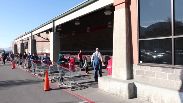 circa - - orem, utah - long line out side grocery store during pandemic for coronavirus. - orem utah stock videos & royalty-free footage