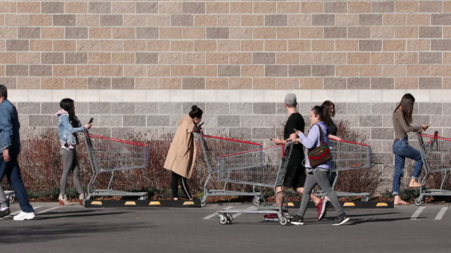 circa - - orem, utah - people standing in line waiting their turn to go grocery shopping during pandemic for coronavirus covid-19. - orem utah stock videos & royalty-free footage