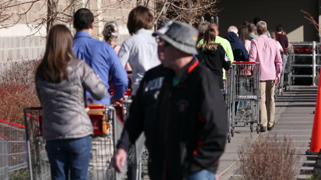circa - - orem, utah - people with shopping carts walking into grocery store in line during the covid-19 pandemic. - orem stock videos & royalty-free footage