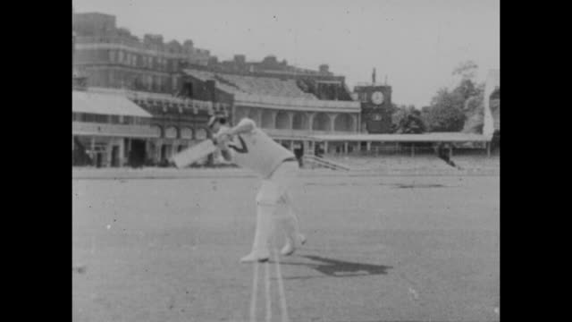 circa 1950s vintage footage of england captain pbh may demonstrating his batting technique filmed at lord's cricket ground in london the film shows... - テストクリケット点の映像素材/bロール