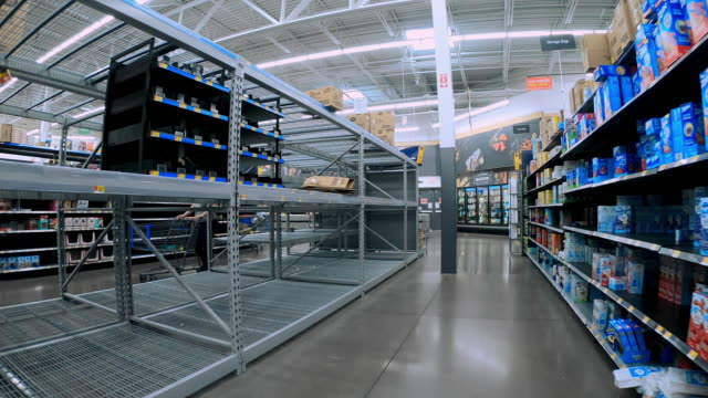 circa - march 13, 2020 - orem utah, empty shelves of toilet paper, paper towels, and disinfectant in a grocery store during coronavirus pandemic as... - cleaning agent stock videos & royalty-free footage