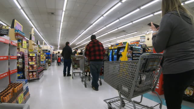 circa march 13 2020 orem utah long line at the grocery store for checkout as people prepare to be quarantined during virus moving worldwide - checkout stock videos & royalty-free footage