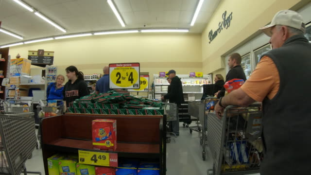 circa - march 13, 2020 - orem utah, long line of people waiting to check out at grocery store as they stock up on supplies during a worldwide... - orem utah stock videos & royalty-free footage