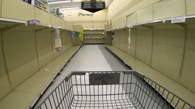 circa - march 13, 2020 - orem utah, view from shopping cart moving down empty grocery aisle as all toilet paper, paper towels, and disinfectant... - shelf stock videos & royalty-free footage
