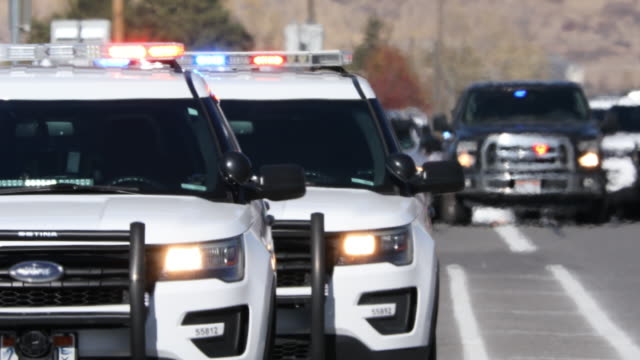 circa october 2019, highland utah: emergency vehicles with lights on blocking the road with heat waves during lockdown at high school. - barricade stock videos & royalty-free footage