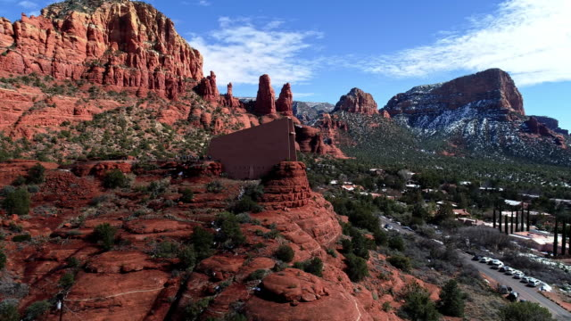 ws circle aerial around red rock mountains and road leading up to chapel of the holy cross built into red rocks of sedona - sedona stock videos & royalty-free footage