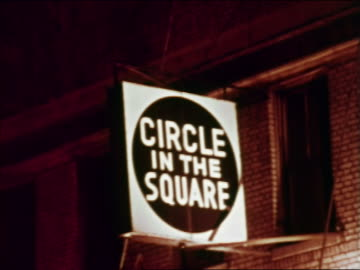 """1969 """"circle in the square"""" sign at night / greenwich village, nyc / industrial - greenwich village stock videos & royalty-free footage"""