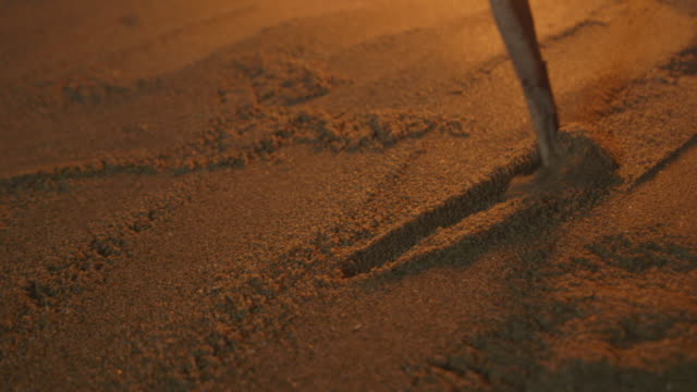 a circle is drawn in sand at night - sand stock videos & royalty-free footage