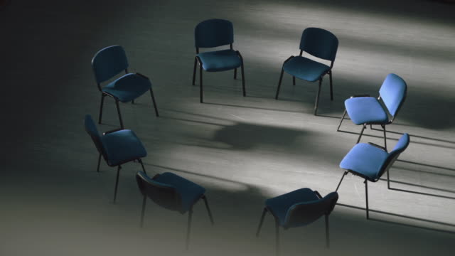 circle of chairs set up for therapy session - image focus technique stock videos & royalty-free footage