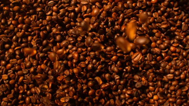 circle of coffee beans falling down 4k - wood grain stock videos & royalty-free footage