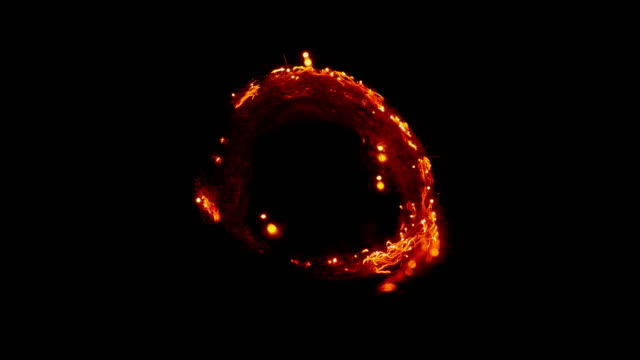 slo mo ld circle shaped fabric kindling and strains of it glowing in the dark - burning stock videos & royalty-free footage