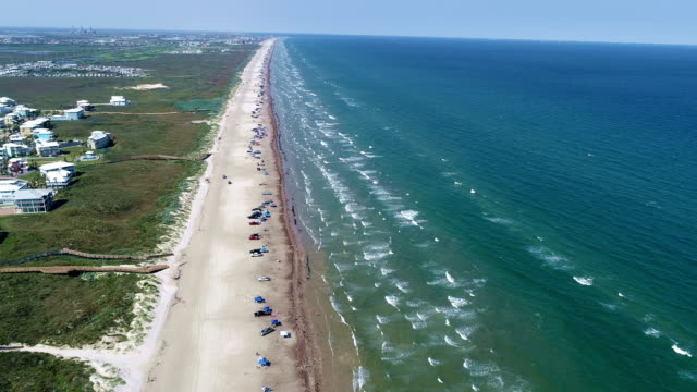 circling above the beach aerial drone view above padre island a gorgeous summer on paradise island - corpus christi texas stock videos & royalty-free footage
