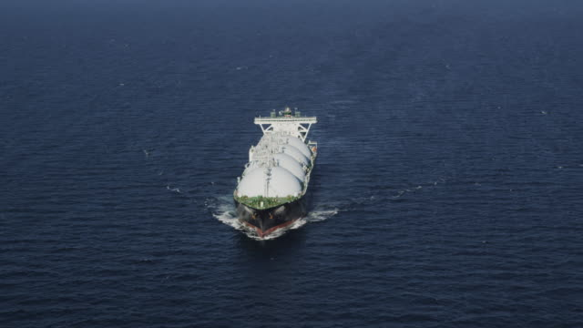 circling aerial view of liquid natural gas (LNG) tanker steaming on the high seas, RED R3D 4K